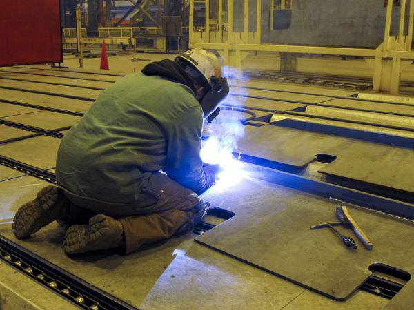 A welder at Aker Philadelphia Shipyard.