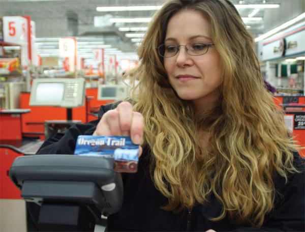 File photo of a woman using her EBT card in Portland, Ore., to purchase food.