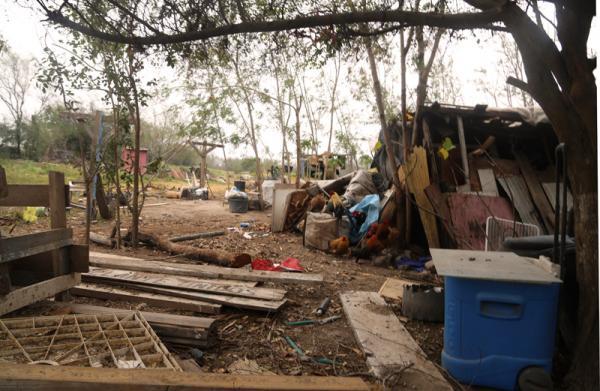 The Aranda family has built shelter using makeshift materials.