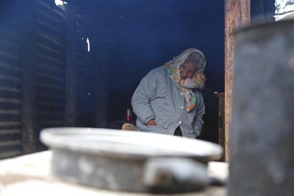 Maria Luisa Aranda is in her 70s and lives in the border town of Progreso. On a cold day in December she kept warm by a fire pit.