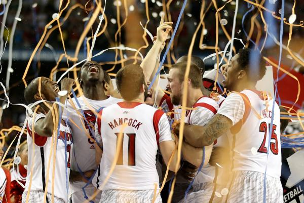 The Louisville Cardinals celebrate after they won 82-76 against the Michigan Wolverines during the 2013 NCAA Men's Final Four Championship on April 8, 2013.  (Andy Lyons/Getty Images)