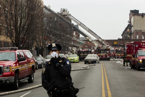 A police officer near the scene of a gas leak explosion that caused two buildings to collapse on Park Avenue and 116th street in the Harlem neighborhood of Manhattan March 12, 2014 in New York City. (Christopher Gregory/Getty Images)