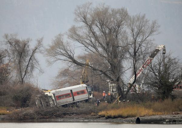 Cranes prepare to salvage the last car from from a train derailment in the Bronx section of New York,  in December 2013.