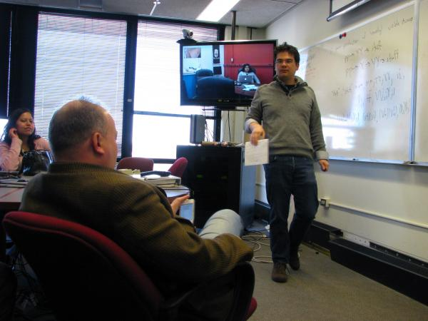 John Paul Chou (right), a physics professor at Rutgers University, uses a whiteboard and answers questions during a forum at Fermilab.