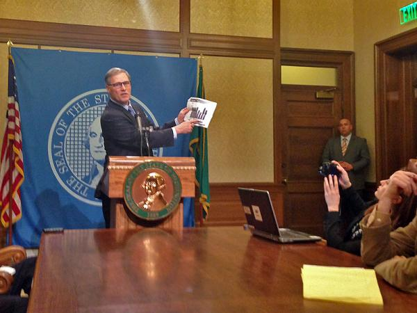 Governor Jay Inslee speaks with reporters at a news conference following the adjournment of the Washington legislature