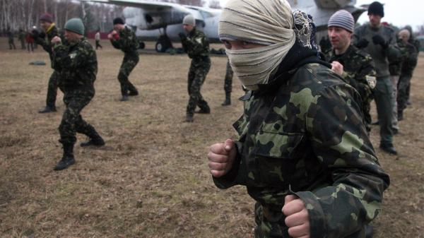 Ukrainian recruits learn unarmed combat techniques during a training session not far from the capital Kiev on Monday. Ukraine says it is mobilizing its forces following  Sunday's vote in which Crimea voted to join with Russia.