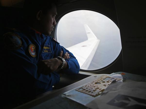 A Malaysia Maritime Enforcement Agency pilot scans the sea below for any sign of Flight 370.