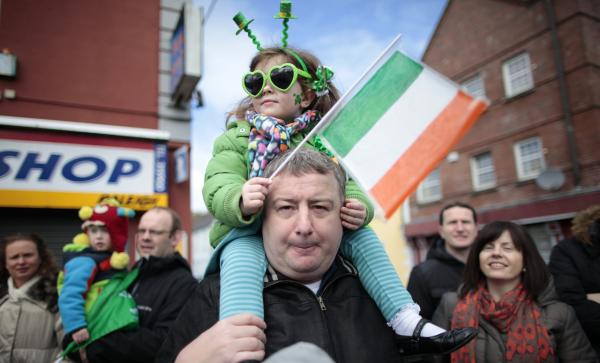A father and daughter enjoy the St. Patrick's Day parade in Limerick, Ireland, Sunday, March 17, 2013. (Peter Morrison/AP)