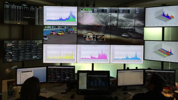In the NASCAR Fan and Media Engagement Center, 13 46-inch TV screens display charts, tweets and live races.