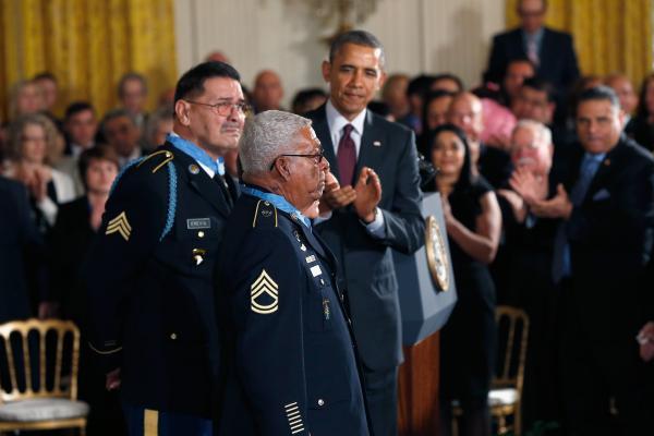 Vietnam veterans Melvin Morris (center), Jose Rodela (obscured) and Santiago J. Erevia (left) received the Medal of Honor from President Obama at the White House on Thursday.