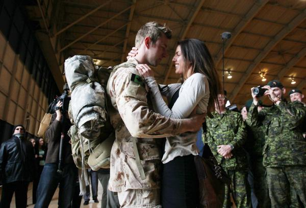 MCpl Anthony Alliot and Sarah Tooth kiss after the last Canadian troops from Afghanistan returned at Ottawa International Airport on Tuesday.