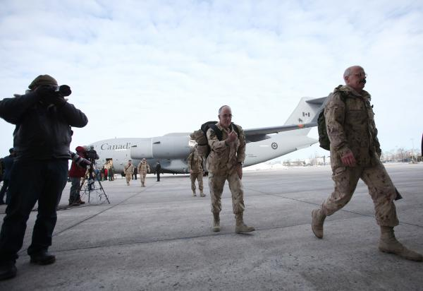 The last Canadian troops to leave Afghanistan deplane as they return to Canadian soil, in Ottawa, Ontario on Tuesday, bringing an end to Canada's longest ever military engagement.