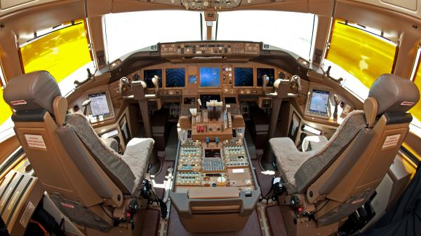 The cockpit of a Boeing 777.