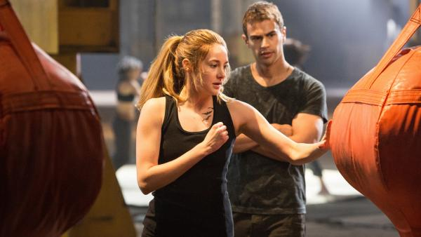 Tris (Shailene Woodley) and Four (Theo James) train hard as part of the warrior faction Dauntless in <em>Divergent</em>, based on the novel by Veronica Roth.