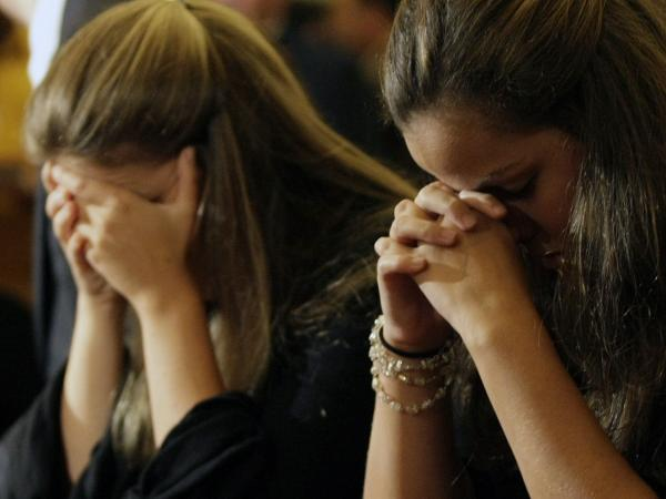 June 5, 2009: Relatives and friends pray for passengers of Air France Flight 447 at the Nossa Senhora do Carmo church in Rio de Janeiro. Those who lost loved ones in that flight are expressing their sympathy and concern for those waiting for word about Malaysia Airlines Flight 370.