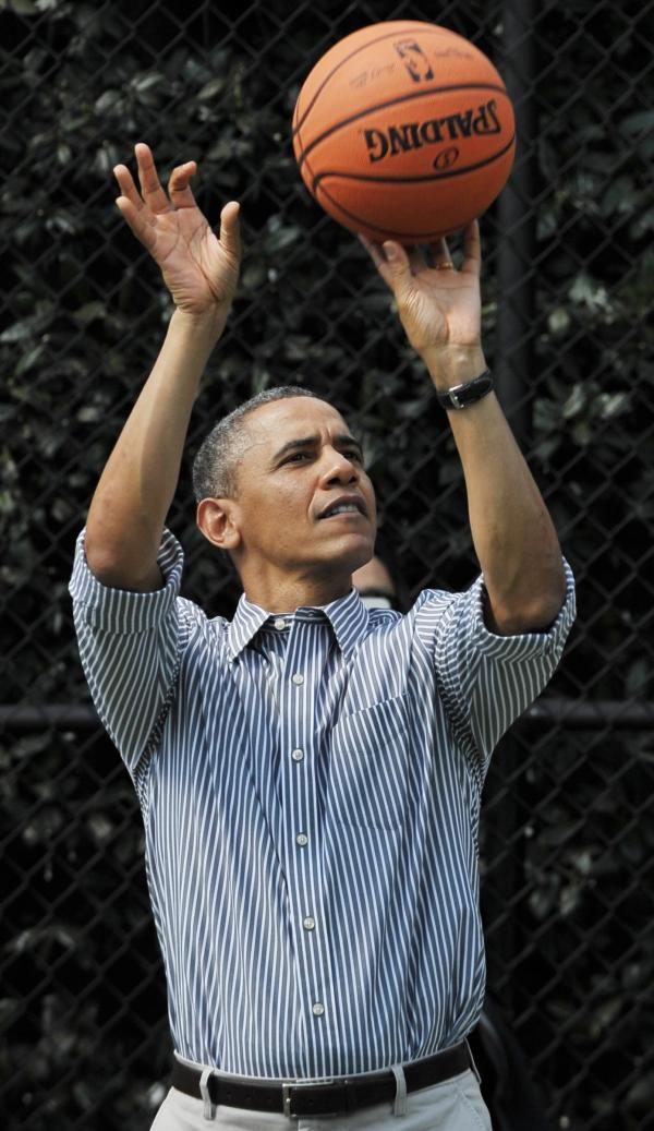 The president is a big fan of the game and still likes to shoot hoops. But has he picked the winner?