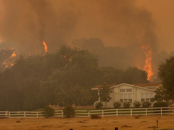Flames approach the Blakiston Ranch in California last May during the Springs fire. It eventually torched more than 24,000 acres.