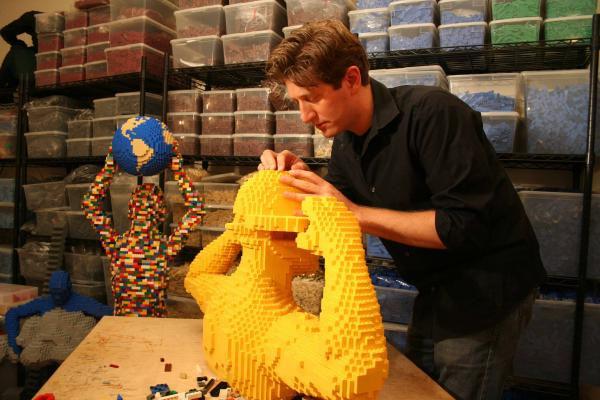 LEGO brick artist Nathan Sawaya in his studio. Can you guess how many bricks he has?