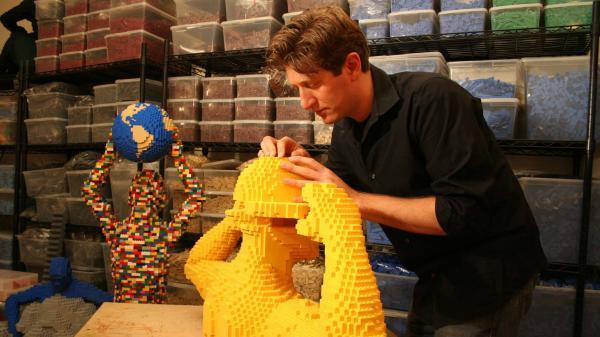 Lego brick artist Nathan Sawaya in his studio. Can you guess how many bricks he has?