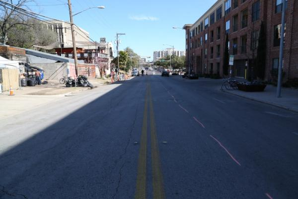 A barriaced Red River Street following Thursday's late morning press conference.