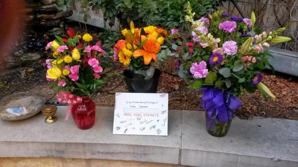 Flowers at a memorial for victims of the crash, at St. David's Episcopal Church.