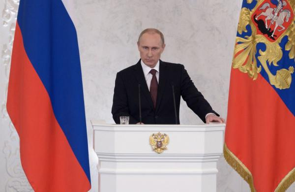 "Russian President Vladimir Putin addresses a joint session of Russian parliament on Crimea in the Kremlin in Moscow on March 18.  Putin sparked controversy when he used the word ""Russkii"" to refer to the Russian people, rather than ""Rossisskii."" (Alexei Nikolsky/Getty Images)"