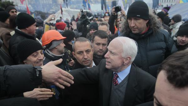 GOP Sen. John McCain greets well-wishers as he arrives to visit a pro-European Union rally in Independence Square in Kiev, Ukraine, on Dec. 15. Strong criticism and trips like this landed the Arizona senator on Russia's travel blacklist.