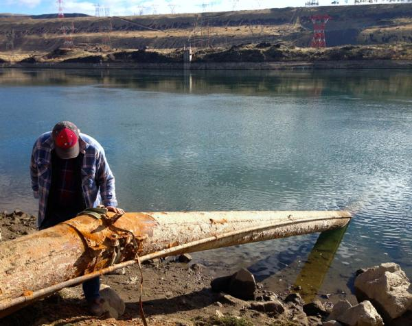 Frosty Hansen, of Wenatchee, Wash., shows off his irrigation pipe that still reaches the river. Unfortunately, it's cracked from the pressure of the river current. He says with a few welding repairs, it should hold through summer.