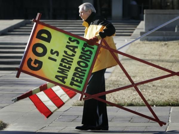 July 2007: The Rev. Fred Phelps Sr. prepares to protest outside the Kansas Statehouse in Topeka, Kan.