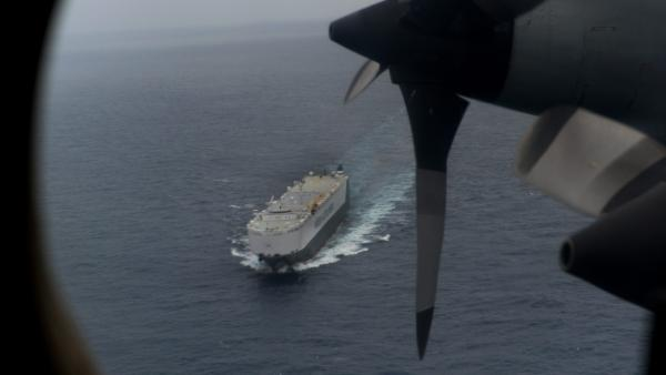 Searching from the air and on the sea: The view Friday from a Royal Australian Air Force P-3 Orion. The Norwegian car transport ship Hoegh St. Petersburg is below. They're part of the search in the southern Indian Ocean for Malaysia Airlines Flight 370.