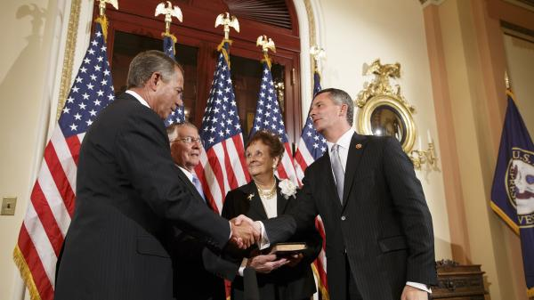 Newly elected GOP Congressman David Jolly of Florida, right, poses for a ceremonial swearing-in with Speaker of the House John Boehner, R-Ohio, on March 13. Jolly edged out Democrat Alex Sink in a special election that Republicans cast as a referendum on President Obama and his unpopular health care law.