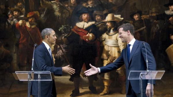 President Obama and Dutch Prime Minister Mark Rutte shake hands in front of Rembrandt's <em>Night Watch</em> after speaking to the press following meetings at the Rijksmuseum in Amsterdam on Monday. Which artwork in the museum best captures the current global mood?