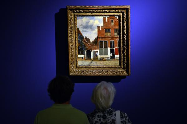 Visitors look at <em>The Little Street</em> by Dutch artist Johannes Vermeer.