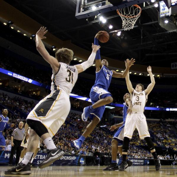 Kentucky's Andrew Harrison goes up for a shot during his team's victory Sunday over Wichita State. The Wildcats' win sent the previously undefeated Shockers home.