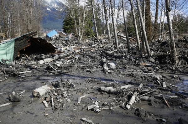 A house sits destroyed in the mud on Highway 530 next to mile marker 37 on March 23, 2014 near Arlington, Washington. (Lindsey Wasson/The Seattle Times via Getty Images)