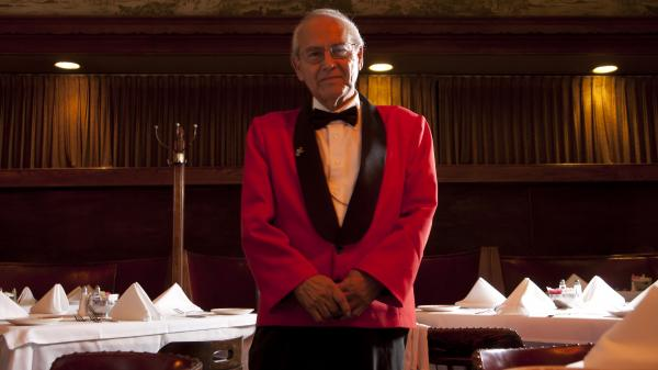 "Waiter Alonzo Castillo — known as Panama — is 82 and has worked at Musso and Frank Grill in LA for 40 years. ""I like it here,"" he says, ""so I keep working."""
