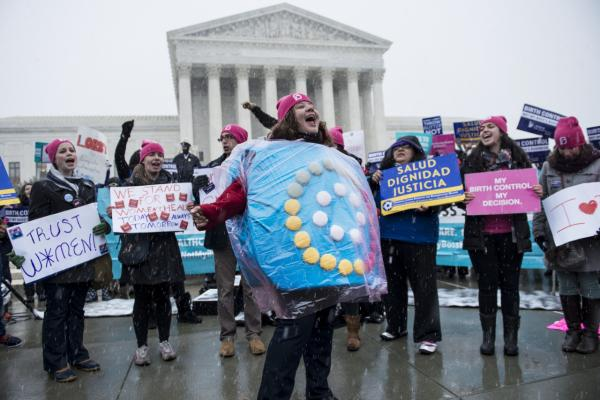 The Supreme Court will hear arguments today if Hobby Lobby and other for profit corporations can refuse to cover contraceptive services in their employee's healthcare for religious reasons. Activists rally outside the Supreme Court March 25, 2014 in Washington, DC. (Brendan Smialowski/AFP/Getty Images)