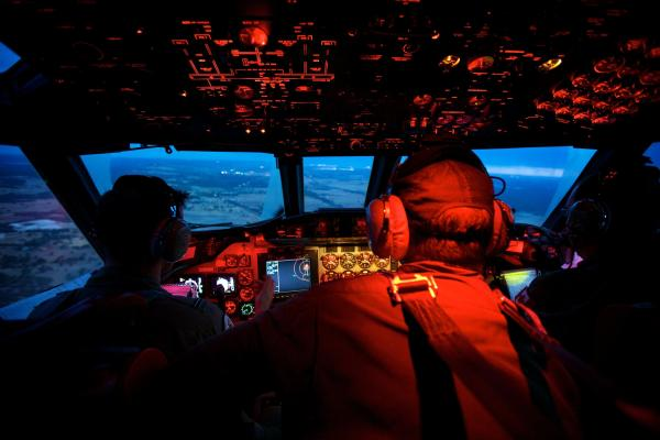 Crew members onboard a RAAF AP-3C Orion cross the coast of Perth, Australia, having just completed an 11-hour search mission for Malaysia Airlines Flight 370.