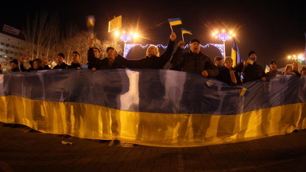 Activists rally for a united Ukraine in Donetsk on March 5. They were attacked by pro-Russia supporters, but Russian media reported that pro-Russian demonstrators were attacked by soccer hooligans.
