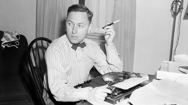 Playwright Tennessee Williams sits at his typewriter on Nov. 11, 1940, in New York.