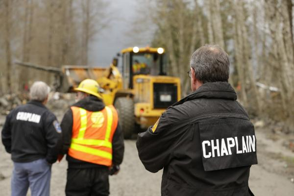 Crews work on Washington State Route 530 to clear debris from a mudslide on March 25, 2014 in Oso, Washington. (Ted S. Warren/Getty Images)