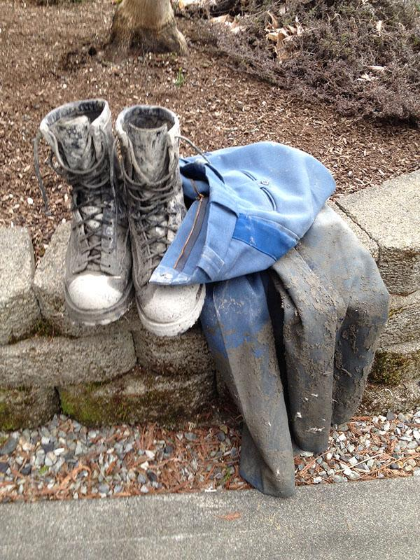 Trooper Rocky Oliphant's muddied boots and uniform pants after wading into the Oso mudslide to help rescue an infant.