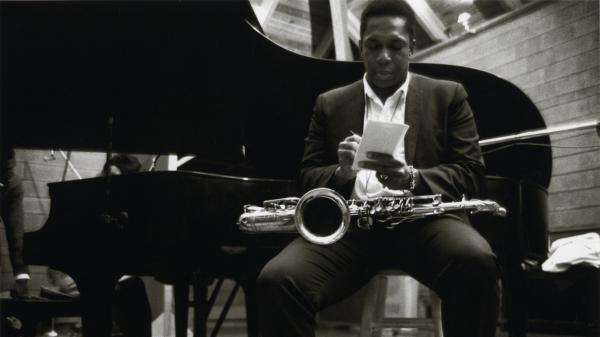 John Coltrane reflects during an April 1966 recording for the album <em>Cosmic Music</em>.