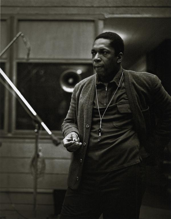 John Coltrane at the recording sessions for <em>A Love Supreme</em>. In addition to the images already published, photographer Chuck Stewart recently unearthed never-before-seen shots of the session, including this one. Per the request of Chuck Stewart's family, reproduction of these photos elsewhere is prohibited.