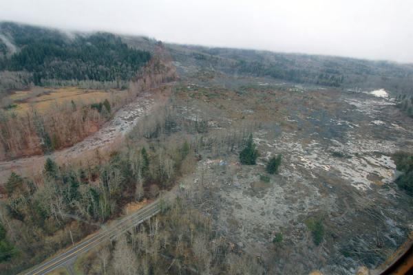 A view of slide debris blocking the Stillagaumish River and Highway 530