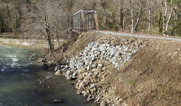 A company that's rebuilding sections of the Port of Tillamook Bay Railroad says it doesn't need a state permit to work on the Salmonberry River.