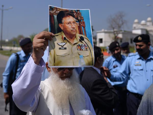 In Islamabad on Monday, this man was among supporters of former Pakistani leader Pervez Musharraf who gathered outside the court where he appeared.