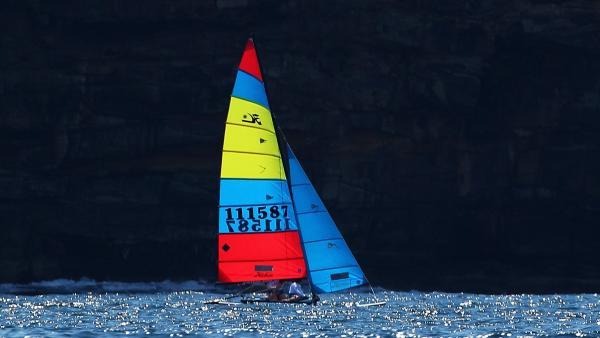Hobie Alter, an innovator whose ideas brought surfing and sailing to wide audiences, died this weekend. Here, one of his Hobie Cat sailboats is seen sailing past North Head in Sydney, Australia.