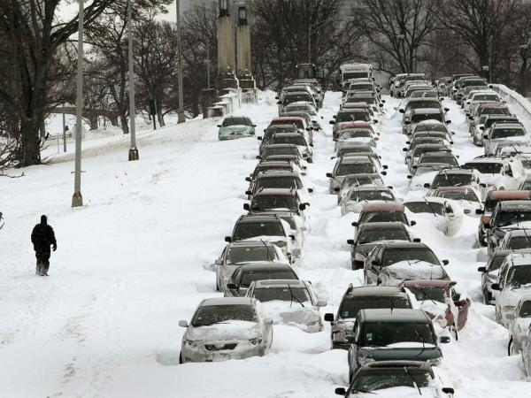 Cars sit in the northbound lanes of Lake Shore Drive after accidents and  drifting snow stranded the drivers during a blizzard in Chicago, Illinois.