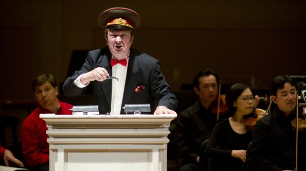 The Houston Symphony and conductor Hans Graf presented an all-Shostakovich evening for their evening at the Spring for Music festival at Carnegie Hal on May 7, 2012. They played two rarely heard works in powerful performances: the bitingly satirical <em>Anti-Formalist Rayok</em>, with soloist Mikhail Svetlov (pictured), as well as the gargantuan Symphony No. 11.